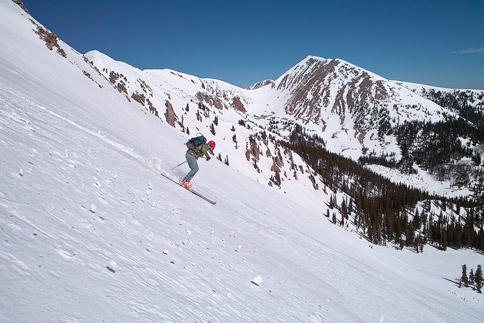 Skiing down Manns Peak