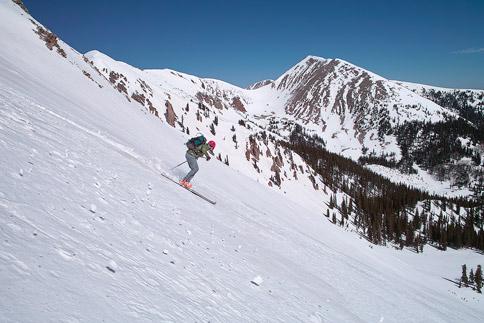 Skiing down Manns Peak