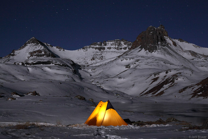 Winter tent at night in the mountains