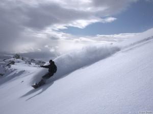 Jason King snowboards