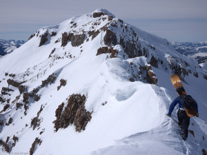 Hiking a snowy mountain ridge