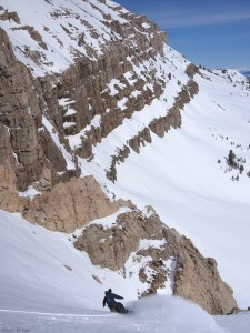 Snowboarding into a steep couloir