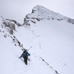 Hiking a steep snowy mountain