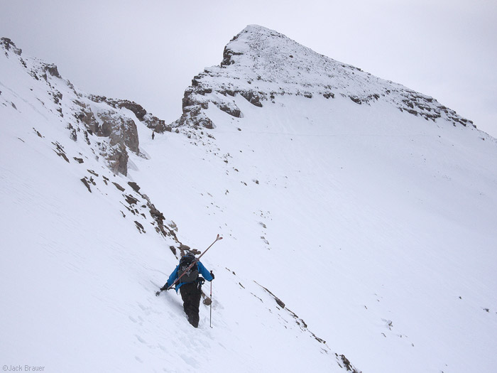 Hiking a steep snowy mountain
