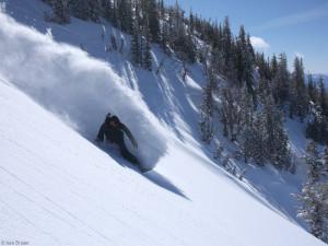 Jason King snowboards powder