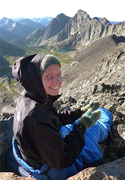 in sleeping bag on summit of Peak 3