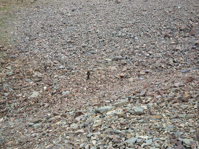 hiking through a rock field
