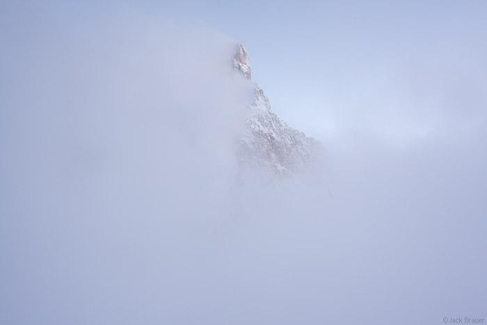 Cimon della Pala summit in the clouds