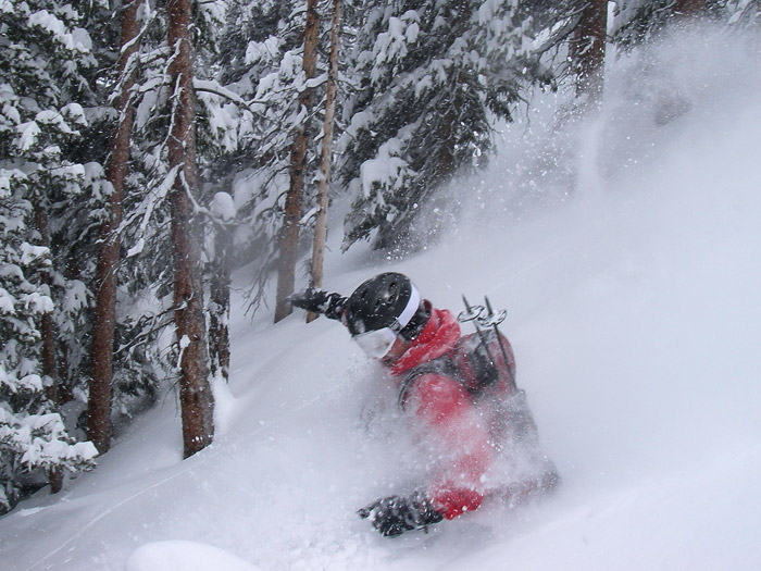 Snowboarding powder in Colorado, May