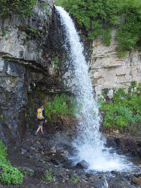 Hiking under a waterfall on Mt. Timpanogos, Utah
