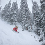 Tom Kelly skis deep powder.